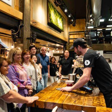 Server explaining options of dessert during Evening Gourmet Food Tour in Quebec City, Cafe Maison Smith, Canada